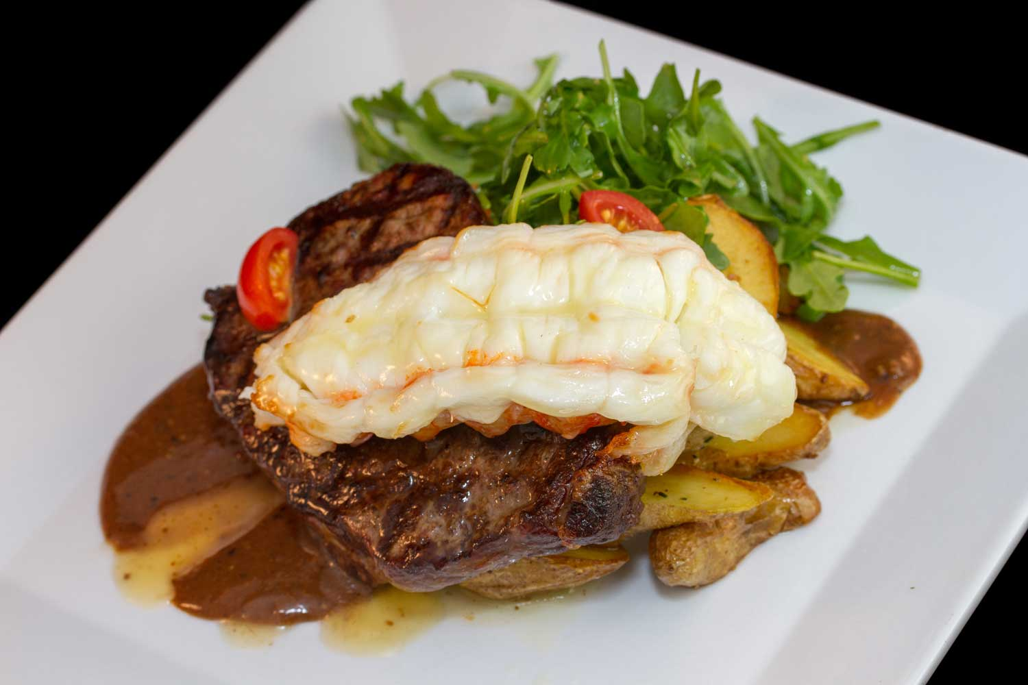 Filet and Lobster prepared by Mount Hill Tavern